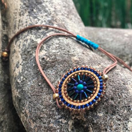 Armbånd med perler i rød/hvid/gul