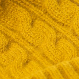 Karrygul strikhue med kvast i cashmere