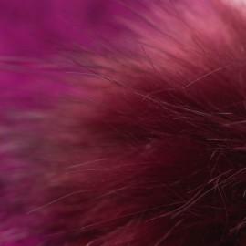 Blommefarvet strikhue med kvast i cashmere